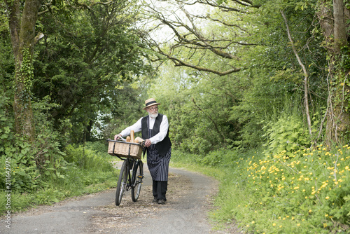 1940 delivery man on a country road rural setting Canvas Print