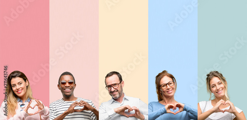 Mixed group of people, women and men happy showing love with hands in heart shape expressing healthy and marriage symbol