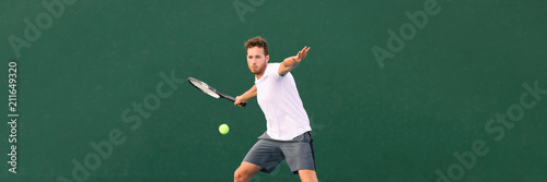 Fotografija Tennis player man hitting ball with forehand hit on outdoor court playing game