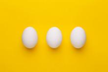Three White Eggs On A Yellow B...