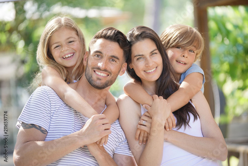 Portrait of happy family on summer day