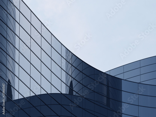 3D stimulate of high rise curve glass building and dark steel window system on blue clear sky background,Business concept of future architecture,lookup to the angle of the corner building Fototapet