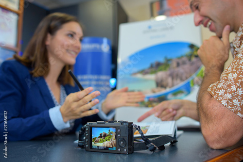 Travel agent with client