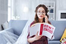 Reading Literature. Young Beautiful Bride Wearing Black Glasses Reading Interesting Modern Literature