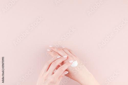 Fotografie, Obraz  Woman moisturizing her hand with cosmetic cream