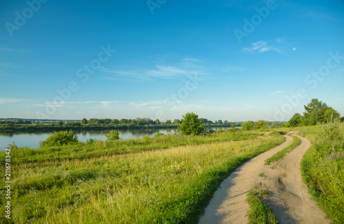 Tuinposter Blauwe jeans a picturesque view, a road along the river