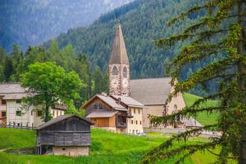 Fototapeta na wymiar Church of Santa Maddalena in Val di Funes, Dolomites, Italy