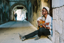 African Musician Playing Guita...