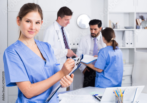 Photo Doctor assistant noting prescriptions