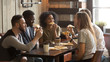 canvas print picture - Smiling multiracial friends eating pizza and drinking coffee, laughing and having fun in restaurant, diverse millennial colleagues enjoying lunch during work break sitting at coffee table in loft cafe