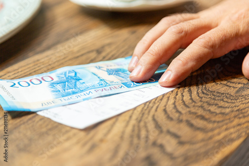 Poster  New Russian banknotes denominated in 2000 rubles to pay the bill