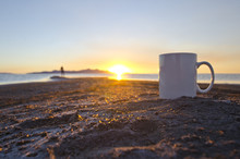A Solo Blank White Coffee Mug Out Int The Open Great Salt Lake Sunset.