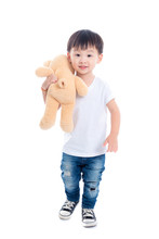 Little Asian Boy Holding Teddy Bear Stuffes Toy And Smiles Over White Background