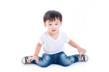 Little Asian Boy Sitting On Th...
