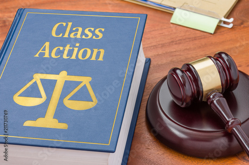Photo  A law book with a gavel - Class action