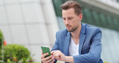 Fotografie, Obraz  Businessman work on smart phone in city
