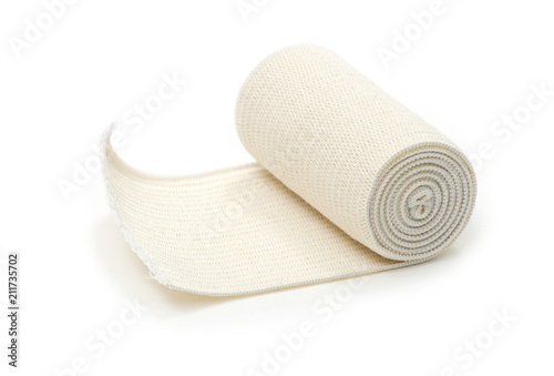 Canvas medical bandage roll on white