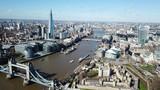 Fototapeta Londyn - Aerial drone bird's eye view of iconic Tower Bridge, the Shard and skyline in City of London, United Kingdom