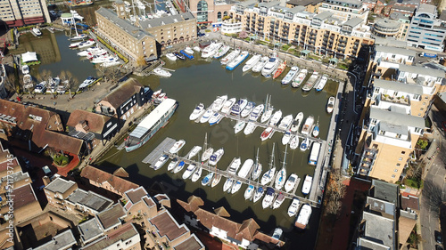 Aerial drone bird's eye view of famous St Katharine Docks Marina and iconic skyl Wallpaper Mural