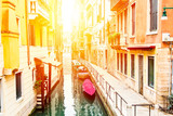 Fototapeta Uliczki - Beautiful narrow canal and street with boats in Venice during summer day, Italy.