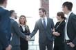 business handshake of businessmen in the office
