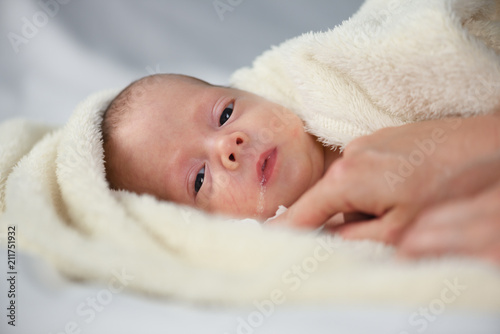 Fotografia, Obraz  Newborn baby boy portrait on white carpet closeup
