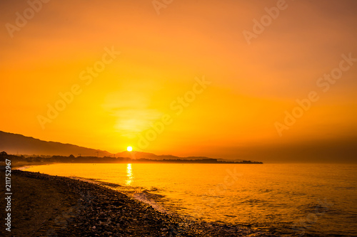Spoed Foto op Canvas Zee zonsondergang Summer sunrise over the mountains and Mediterranean Sea in Southern Spain