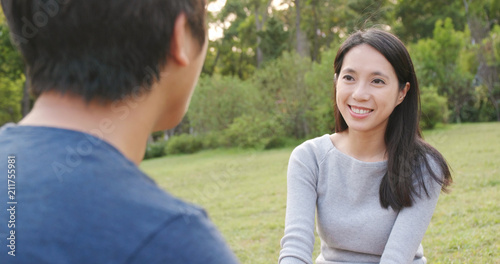 Fototapety, obrazy: Couple chatting together at outdoor park