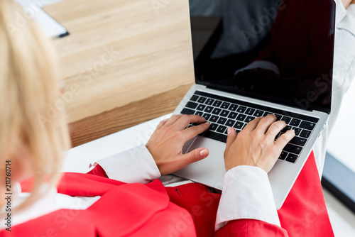 Fotografie, Obraz  cropped image of businesswoman working with laptop in office