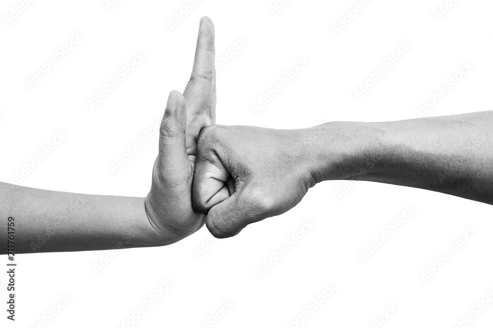Fototapeta woman using hand palm to stop man's punch from attack isolated on white background. stop violence against women campaign concept with copy space, black and white color