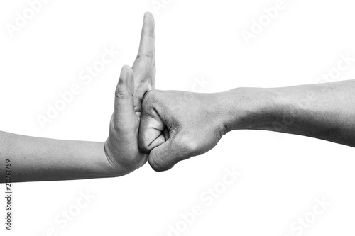 Cuadros en Lienzo  woman using hand palm to stop man's punch from attack isolated on white background