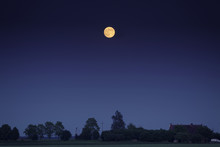 Full Moon Over Scenic Countryside Fields