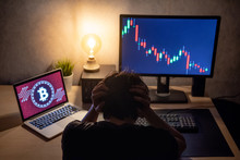 Male Investor Feeling Stressed And Frustrated Due To Bitcoin Crisis With Candlestick Graph Price Down On Laptop Screen. Bitcoin Cryptocurrency Digital Money Crisis Concept