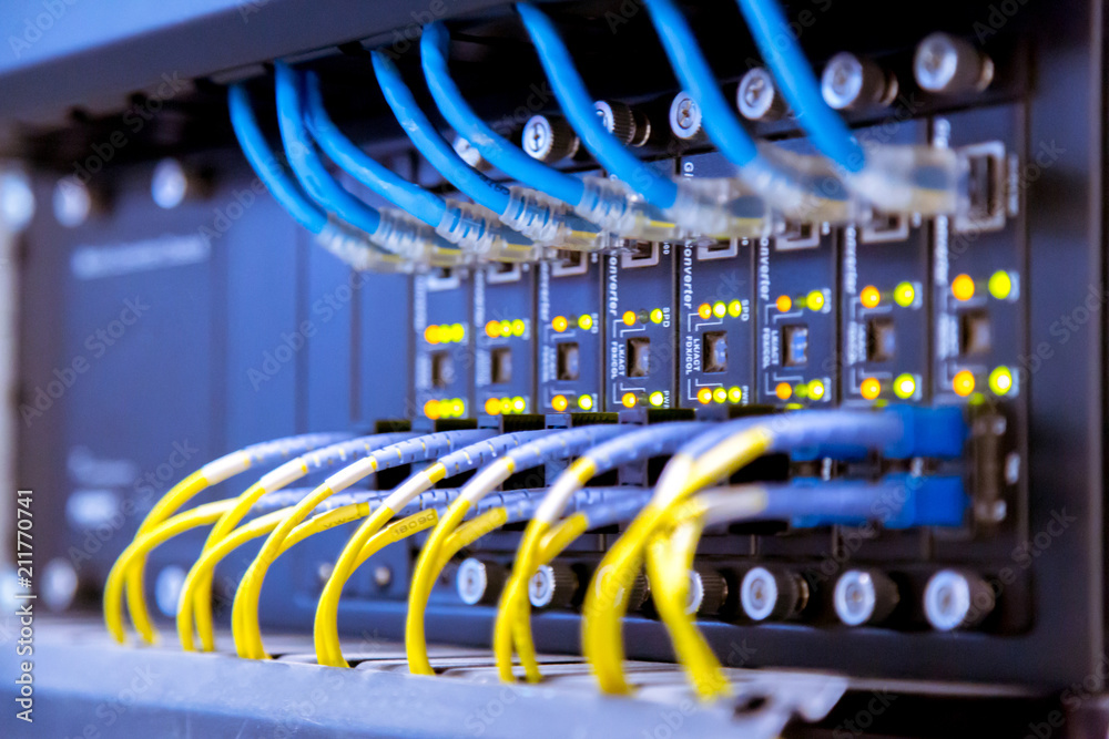 Fototapeta Network switch and ethernet cables,Data Center Concept.