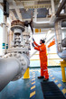 Offshore oil and gas operations, production operator open manual operated valve for control gas flow rate in process gas platform