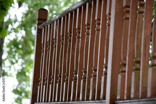 Photo darker stain wood balusters for deck railing