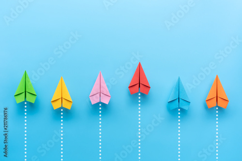 Tela Paper plane on blue background, Business competition concept.