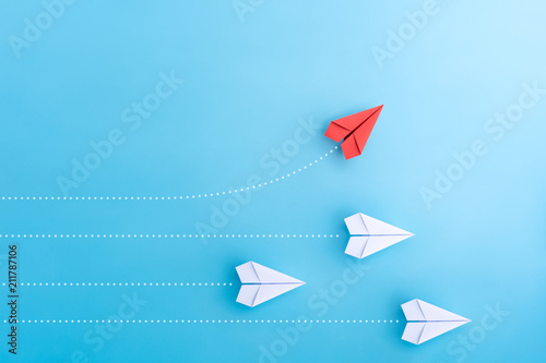 Obraz Group of paper plane in one direction and with one individual pointing in the different way. Business concept for new ideas creativity and innovative solution. - fototapety do salonu