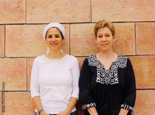 Portrait attarctive mature women standing next to the wall