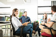Woman smiling in meeting with colleagues