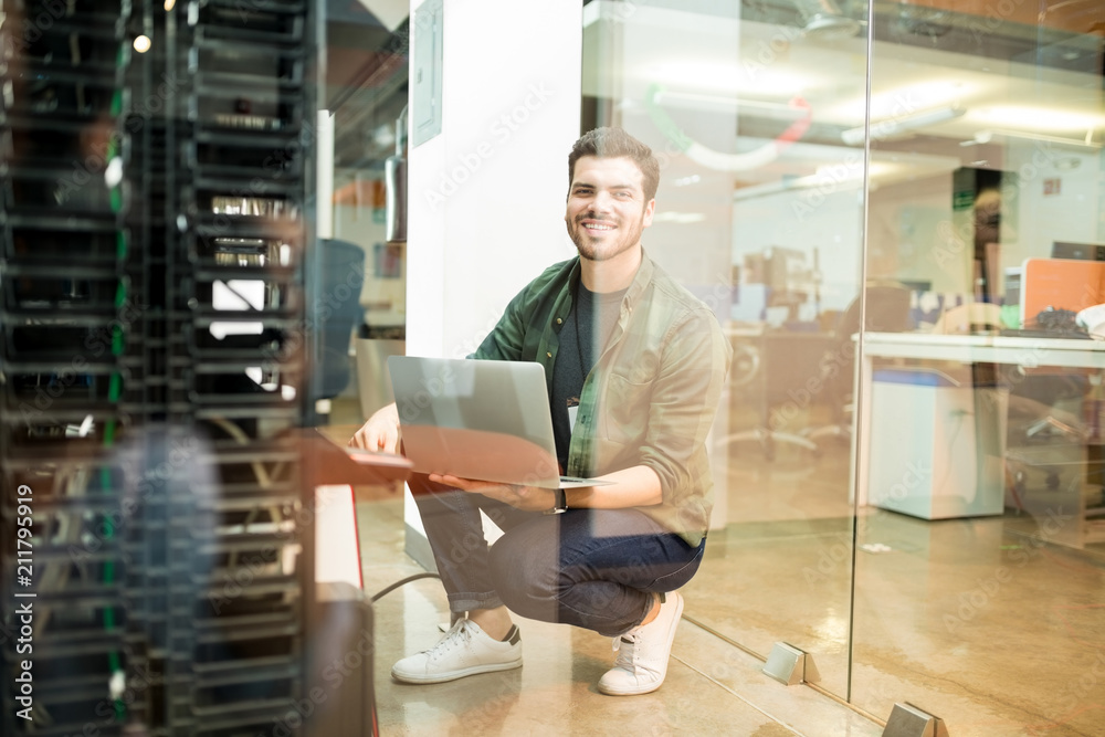 Fototapeta Network engineer working in datacenter