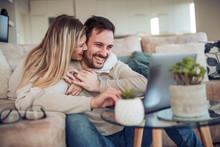 Cheerful Couple Enjoying At Home