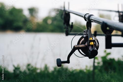 Cuadros en Lienzo Fishing on the summer lake with fishing rod