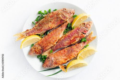 Fototapeta fried breaded fishes with lemon obraz