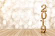 Leinwanddruck Bild - 2019 happy year wood number in perspective room with sparkling bokeh wall and wooden plank floor.copy space for display of product or text.