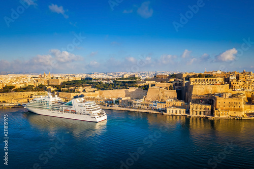 Poster Mediterranean Europe Valletta, Malta - Cruise ship in the Grand Harbor at sunrise with the ancient city of Valletta at background