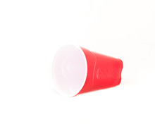 Studio Shot One Disposable Party Cup Isolated On White Background. Red Picnic Cup Recycle Mug Close-up With Clipping Path And Copy Space