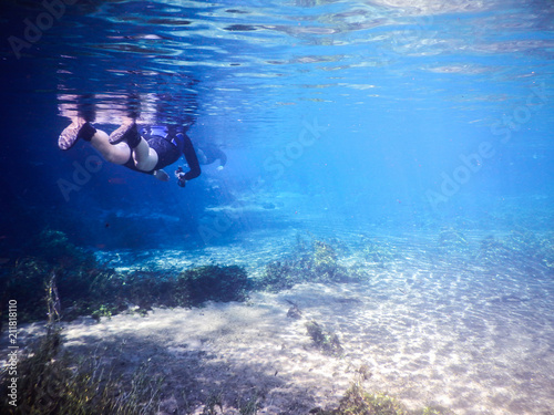 Fotografie, Tablou  Practicing diving and snorkeling, mysterious lagoon, beautiful lagoon of transpa