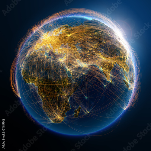 Photo Highly detailed planet Earth is covered by complex network of air routes based on real data