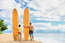 Beach Surfers Watching Waves. ...